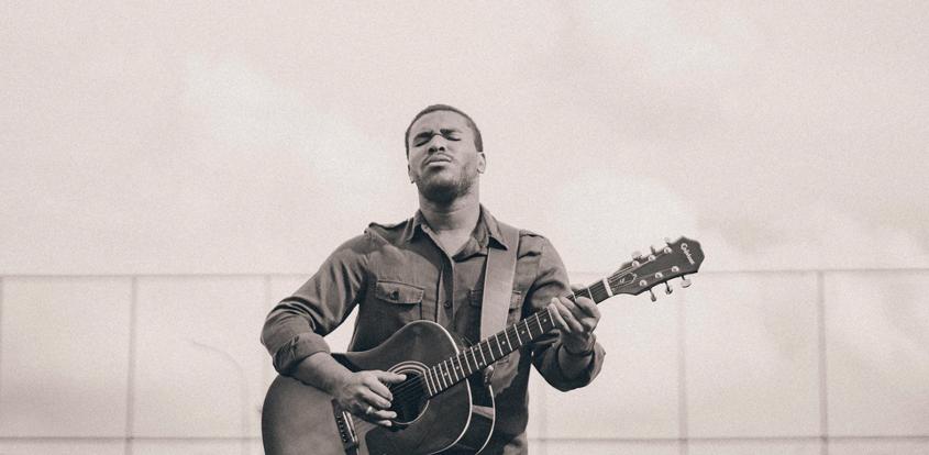 young man playing at guitar, vintage image